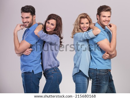 casual women leaning on their men and smile to the camera - stock photo