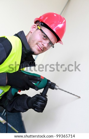 Casual worker with drill