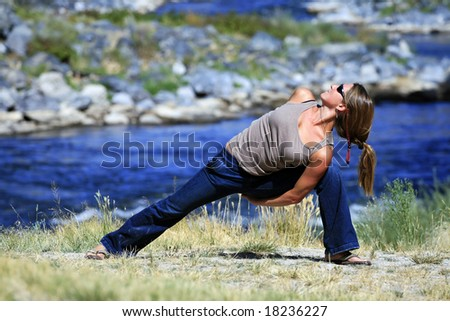 Casual Yoga by the River - stock photo