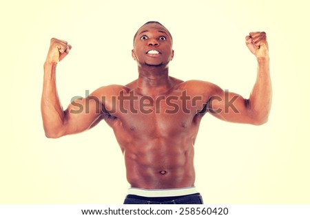 Casual young african muscular man wtih hands up.