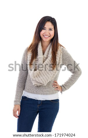 Casual young Asian woman with hand on hips isolated on a white background