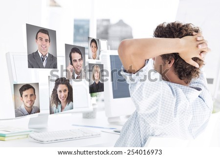 Casual young business man using computer against profile pictures