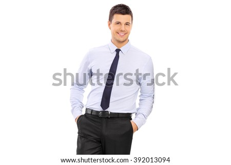 Casual young businessman leaning against a wall isolated on white background