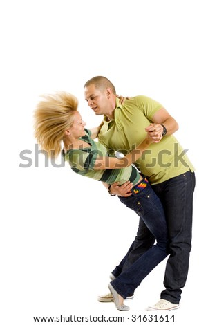 casual young couple dancing over white background