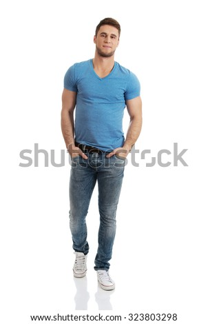 Casual young fashionable man posing on the floor. - stock photo