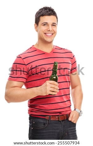 Casual young guy drinking beer isolated on white background - stock photo
