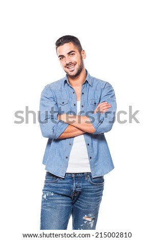 Casual young handsome man in jeans looking at camera