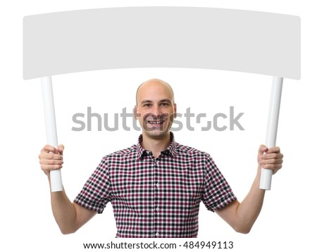 Casual young man holding a blank board on stick. Isolated on white background