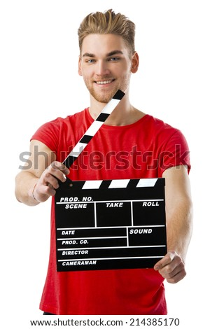 Casual young man holding a clapboard, over a white background - stock photo