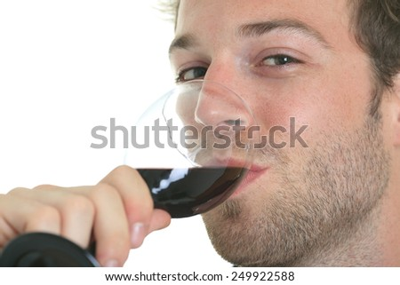 Casual young man holding glass of wine, smiling. Isolated on white.