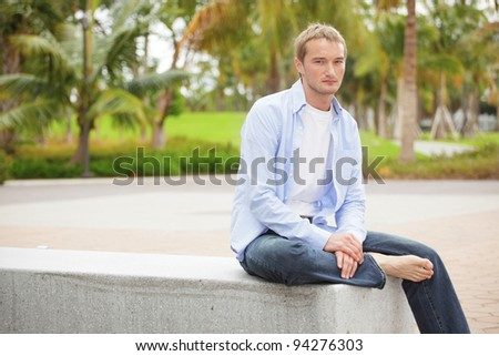 Casual young man in the park - stock photo