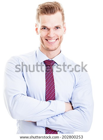 Casual young man looking at camera with arms crossed and satisfaction - isolated on white