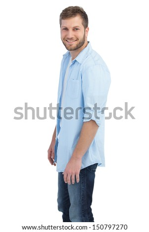 Casual young man on white background looking at camera  - stock photo