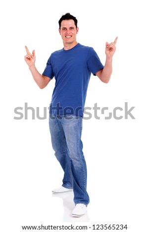 casual young man pointing on white background - stock photo