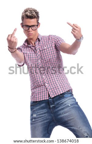 casual young man showing his two middle fingers while looking angrily at the camera. on  white background - stock photo