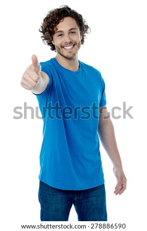 Casual young man showing thumb up gesture - stock photo