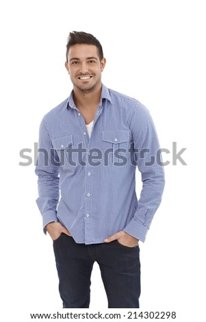 Casual young man smiling, hands in pocket.