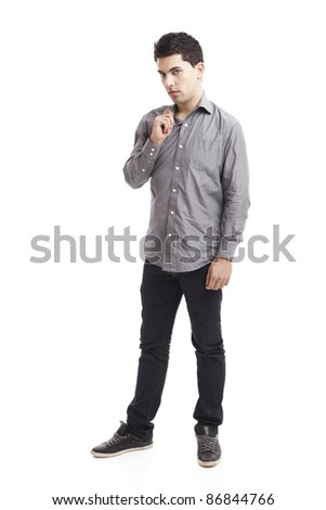 Casual young man standing over a white background - stock photo