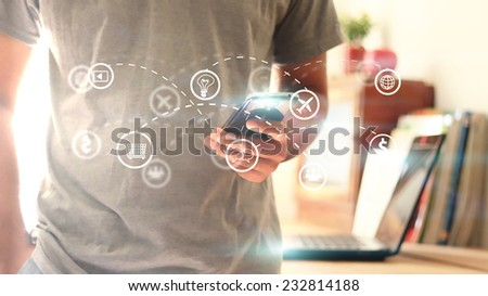 Casual young man using mobile smart phone.  - stock photo