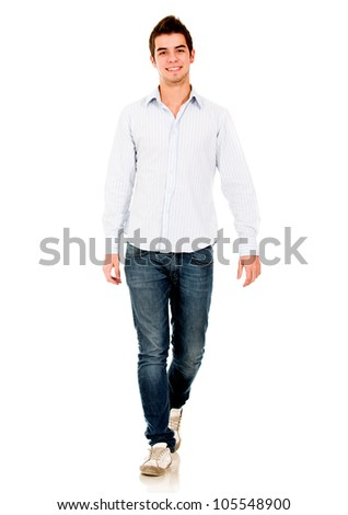 Casual young man walking - isolated over a white background - stock photo