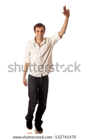 Casual young man waving. Studio shot over white. - stock photo