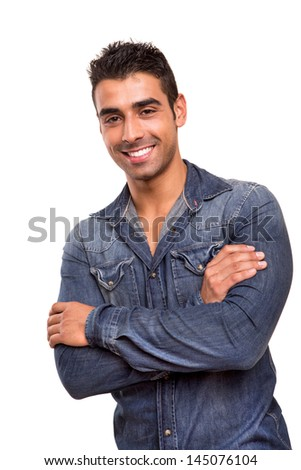 Casual young man with arms crossed and smiling
