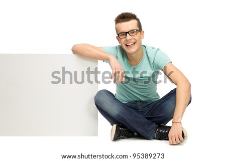 Casual young man with blank sign