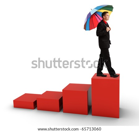 Casual young successful business man walking with big colorful umbrella on growing statistic bars - stock photo