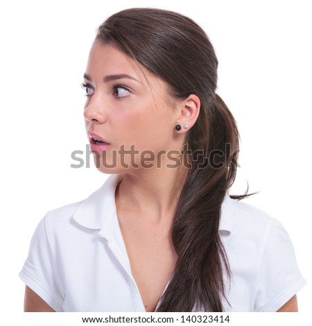 casual young woman looking frightened to her side. isolated on white background - stock photo