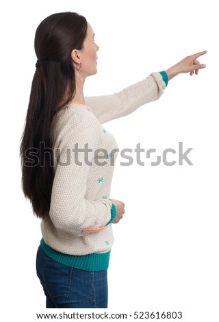 casual young woman pointing finger to copy space. Isolated