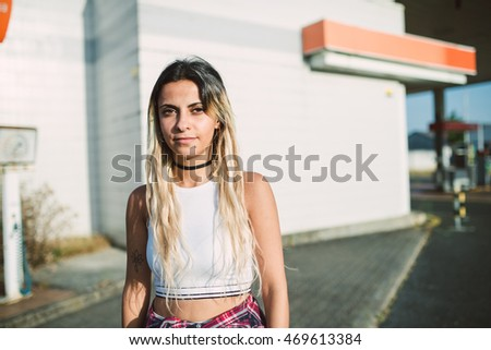 Casual young woman portrait looking at camera.