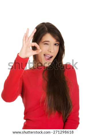 Casual young woman showing perfect sign. - stock photo