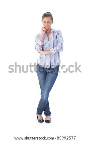 Casual young woman smiling, looking at camera.? - stock photo