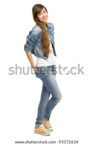 Casual young woman standing - stock photo