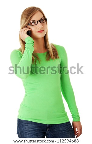 Casual young woman using cellphone. Isolated on white - stock photo