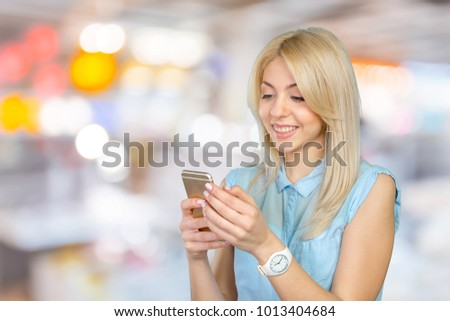 Casual young woman using mobile phone