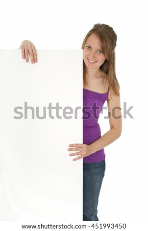 Casual young women holding a blank banner ad, smiling. Isolated on white. - stock photo