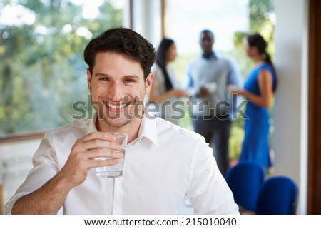Casually Dressed Businessman At Meeting In Boardroom - stock photo