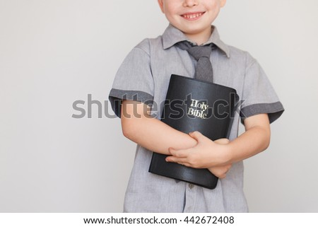 Casually Dressed Christian Boy Holding Holy Bible. High quality picture