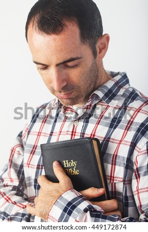 Casually Dressed Christian Guy Holding an Holy Bible - stock photo