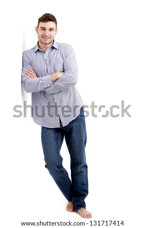 Casually dressed handsome man leaning isolated on a white background - stock photo