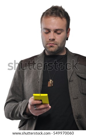 Casually dressed man checking his smartphone isolated on white background