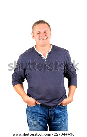 Casually dressed middle aged man smiling. 3/4 view of man shot in vertical format isolated on white. - stock photo