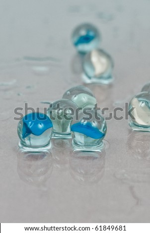 Cat Eye Marbles on Water in Cyanotype Filtering - stock photo