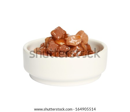Cat food in bowl on white background - stock photo