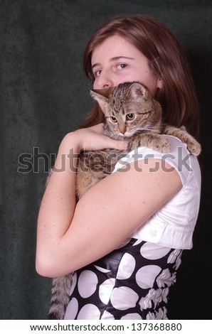 cat held by a young woman