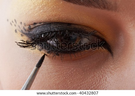 cat make up for girl in progress - stock photo