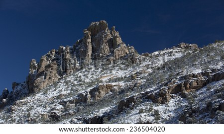 Catalina Mountains slope dusted with snow, viewed from a Mount Lemmon vista, high above the Sonoran desert of Tucson, Arizona, in America's Southwest; - stock photo