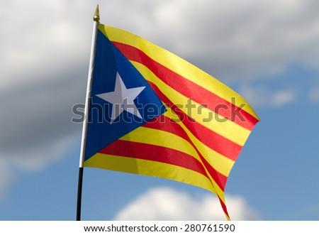 Catalonia flag on sky background. - stock photo