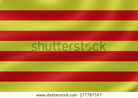 Catalonia flag on the fabric texture background